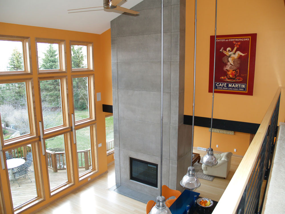 top down angle of custom concrete fireplace with gray stain