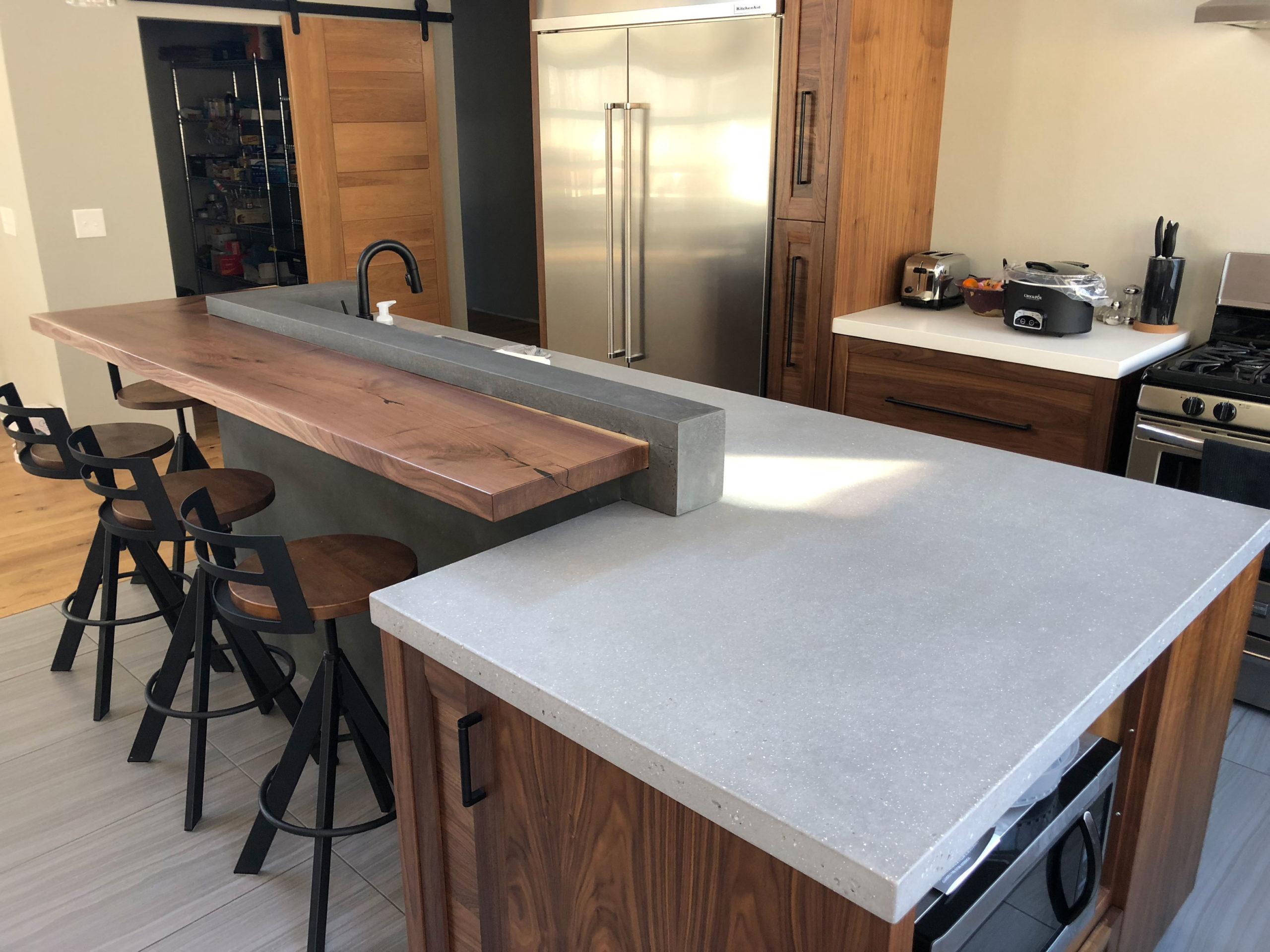 two tiered custom concrete residential counter top with gray stain
