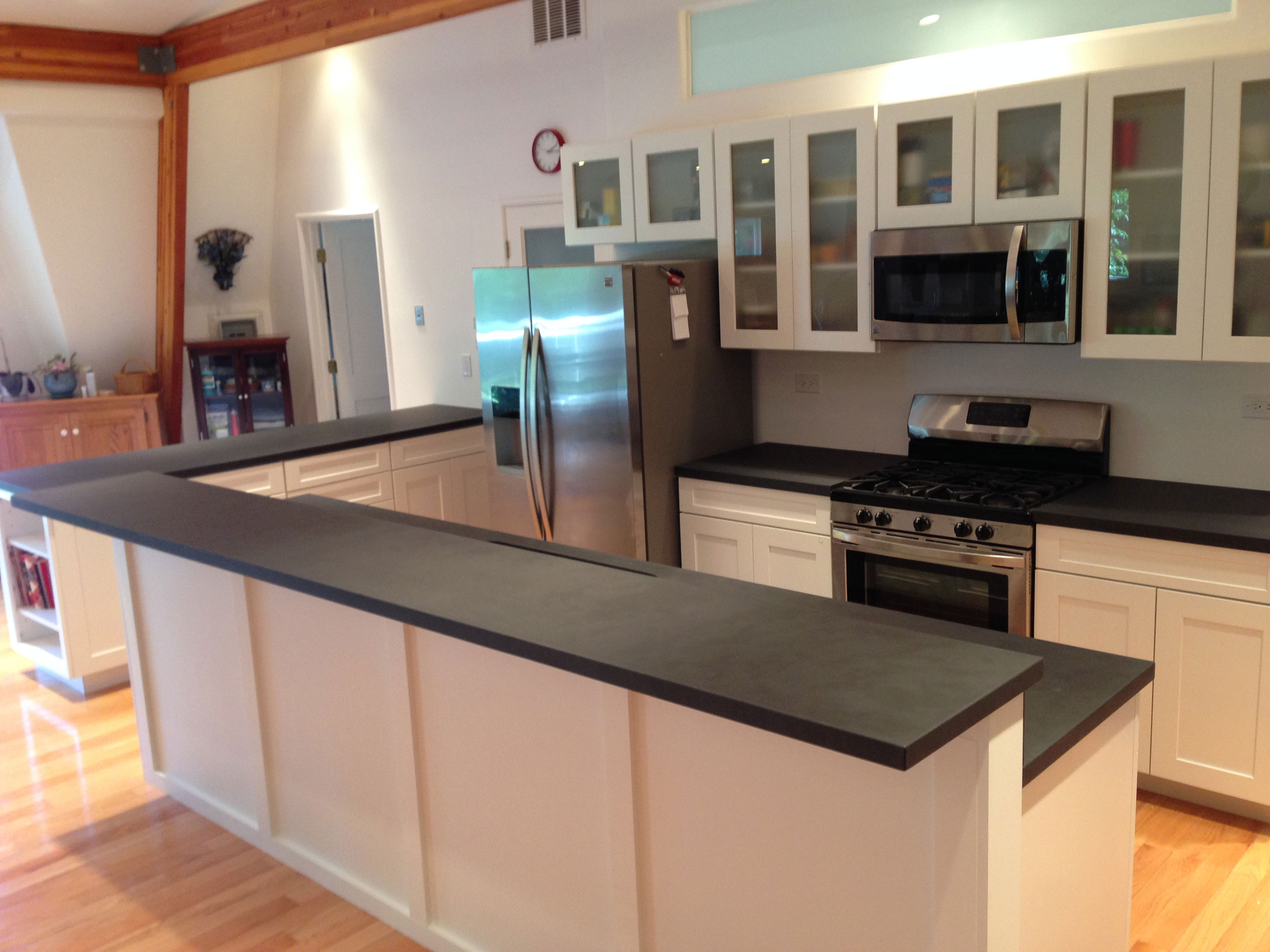 two tiered custom concrete residential counter top with black stain