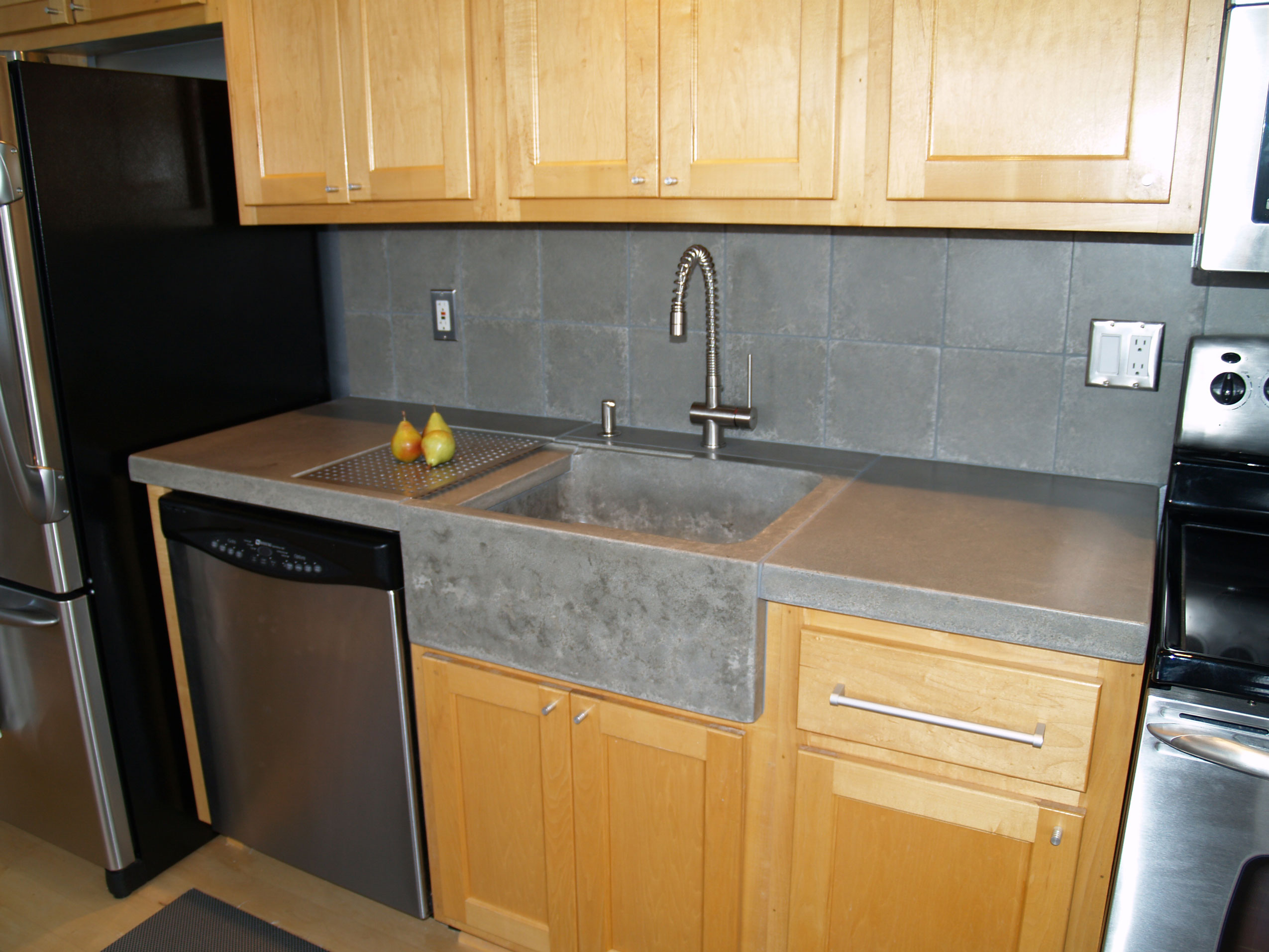 custom concrete residential kitchen counter top with gray stain
